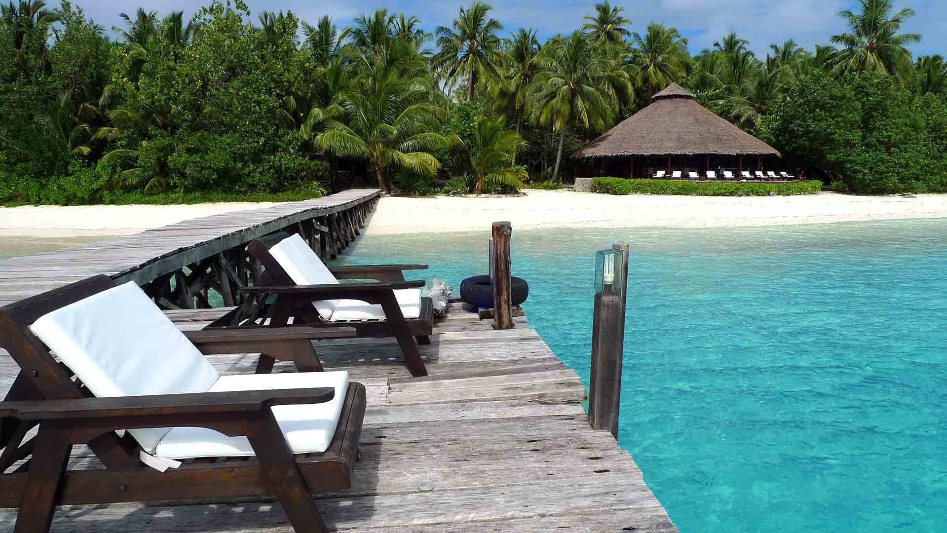 Two chairs on the path way of a secluded beach resort